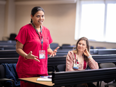 "Valerie Plested, right, listens as Ramya Tata, gives her ""elevator speech"" during Preparing for Success class."