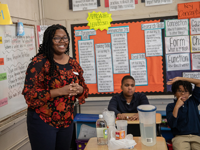 Graduate student Adesuwa Ekunwe leads a lesson at Barack H. Obama Magnet School.