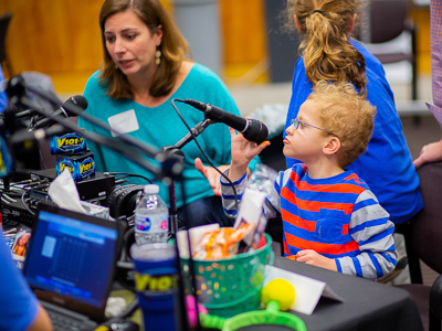 Charlie and mother Kimberly Cleland of Madison broadcast their medical story live at Mississippi Miracles Radiothon.