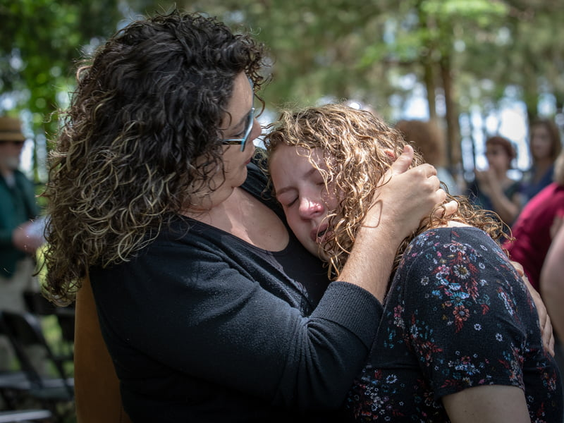Elizabeth Steelman and her daughter Jasmine Steelman give in to a moment of grief as they remember father and grandfather Norville Jackson, one of 150 body donors honored Wednesday during the Ceremony of Thanksgiving.