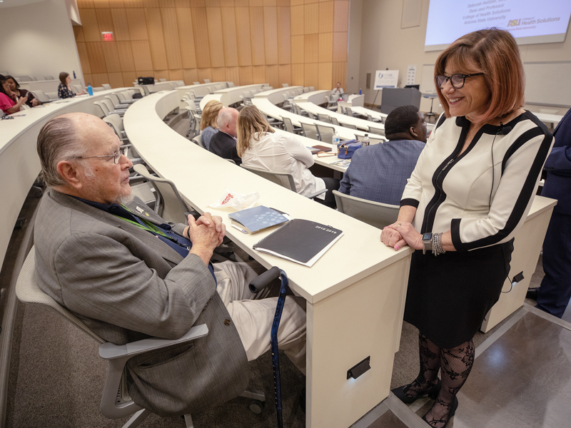 Dr. John Bower, former UMMC nephrologist and namesake of the School of Population Health, speaks with Dr. Deborah Helitzer, Dean of the College of Health Solutions at Arizona State University prior to her lecture.