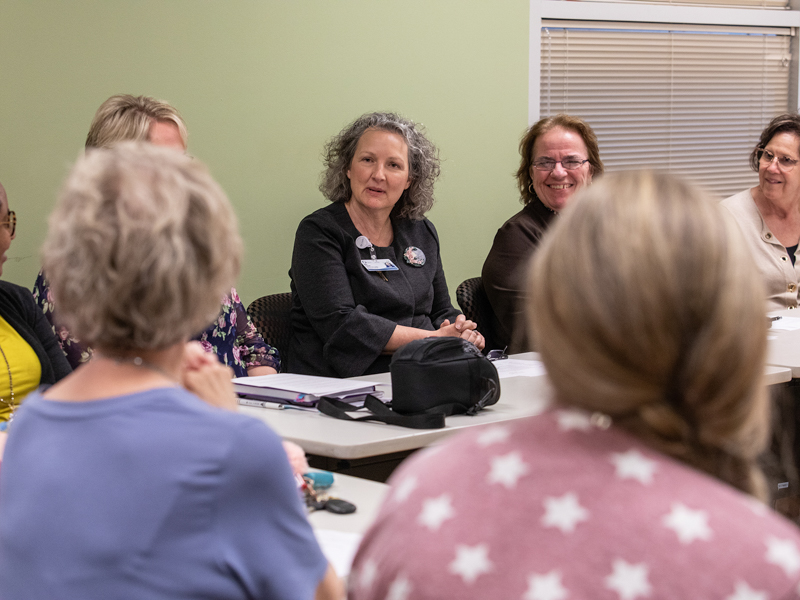 Ellen Hansen, chief nursing officer at Batson Children's Hospital, talks with FAST members and hospital leaders during the group's April meeting.