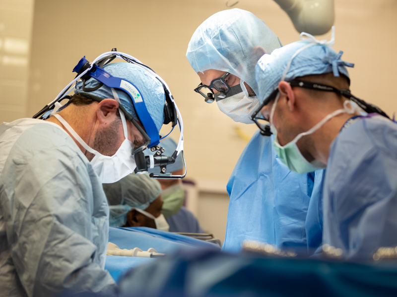 Dr. Mohammed Ghanamah, center, and Dr. Brian Kogon, left, perform a pediatric surgical procedure.