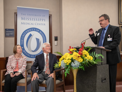 "With Dr. Jean Arceneaux and Dr. Lincoln Arceneaux looking on, Dr. Jerry Clark, chief student affairs officer and associate dean for student affairs, describes the fondness for ""all things south Louisiana, which he and his predecessor share."