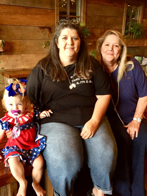 Robin Rhodes, center, mom of the late Randy Rhodes, met Fleeta Hutchison of Pearl, right, who received Randy Rhodes' liver. Also pictured is Robin Rhodes' granddaughter, Amberlynn Rhodes.