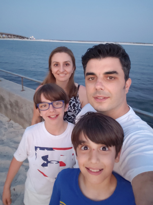 Alper Coban, back right, with his sons Furkan and Kayra, and his wife Seval, at a Florida beach during a soccer trip last year.