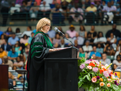 Dr. Woodward speaking at the 2019 commencement ceremony.