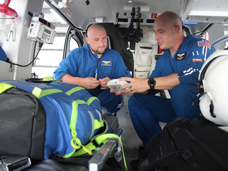AirCare 2 flight paramedic Ben White and flight registered nurse Brock Whitson check equipment before transporting a patient. Bill Graham/The Meridian Star