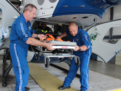 AirCare2 flight registered nurse Todd Perry, left, and flight paramedic Ben White unload a gurney from the helicopter at the Meridian base. Bill Graham/The Meridian Star