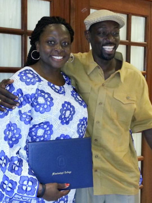 Olubusola Hall, left, and her brother Oluwaseun at Hall's graduation from nursing school at Mississippi College in 2015.