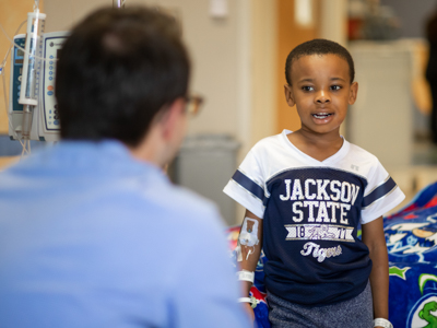 Seven-year-old Princeton Donelson, a patient at Batson, tells Alex Rueff about his family while a patient at Batson. Rueff served in the student chaplain position as a fourth-year medical student.