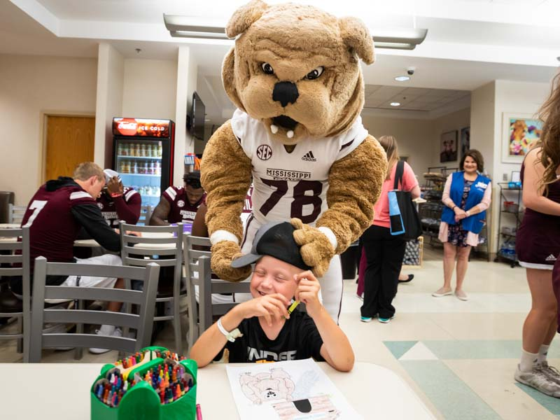 Photos: Football players kick off fun for Children's of Mississippi patients