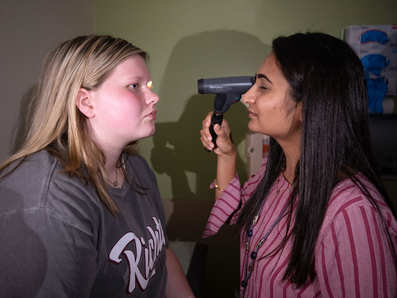 Dr. Riddhiben Patel gives migraine patient Kalli Dykes of Richton an exam during a headache clinic day at the Children's of Mississippi Specialty Clinic.