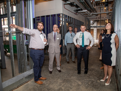 UMMC project manager Brian Reddoch, left, takes hospital leaders including, second from left, Associate Vice Chancellor for Clinical Affairs Dr. Charles O'Mara, Children's of Mississippi CEO Guy Giesecke and Dr. Mary Taylor, chair of the Department of Pediatrics.