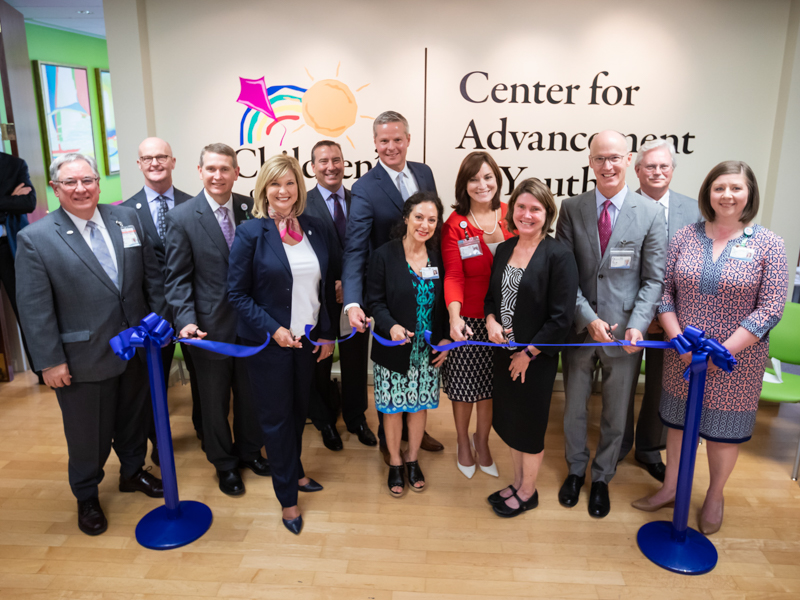 Celebrating the ribbon-cutting for the new location of the Center for Advancement of Youth are, from left, Dr. Ralph Didlake, Dr. Charles O'Mara, Guy Giesecke, Dr. LouAnn Woodward, Kevin Cook, Dr. David Elkin, Dr. Susan Buttross, Dr. Mary Taylor, Anne Travis, Dr. Scott Rodgers, Dr. Richard Summers and Dr. Barbara Saunders.