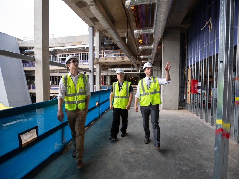 Checking the children's hospital expansion project's progress are, from left, Nate McKenney, construction coordinator; Wesley Smith, nurse manager; and Chris Collado, clinical liaison.