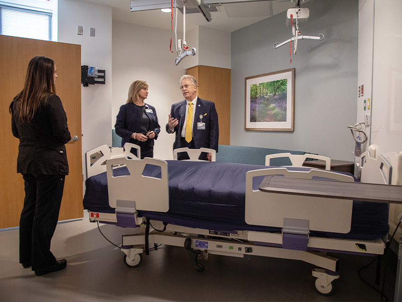 Vaughn, Woodward and Marshall visit a patient room during the dedication of the CRTU at the University of Mississippi Medical Center.