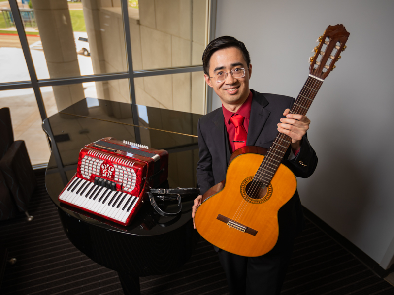 Dr. Frank Han plays a variety of musical instruments, including the piano, accordion and classical guitar.