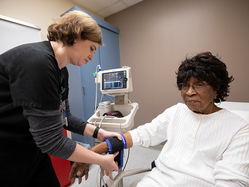 Recent research shows controlling blood pressure to a target of 120/80 mmHg may reduce the risk of mild cognitive impairment for older adults like Lillie Rose Hines of Braxton, pictured having her blood pressure measured by Pamela Burleson, UMMC nurse.