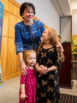 Children's of Mississippi patient Avery Bell, right, and her little sister, Milly Jean, enjoy meeting Gayle Benson.