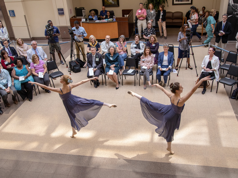 Dancers from Ballet Mississippi perform a selection for an audience of about 100 people gathered in the main lobby of the Medical Center.