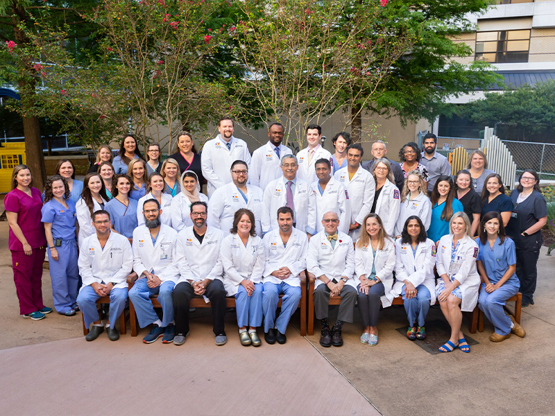 The Children's Heart Center at UMMC has never before had so many experts caring for young cardiology patients. The team stopped in the Rainbow Garden for a photo this summer.