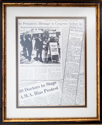Dr. Robert Smith owns these framed newspaper clippings chronicling the efforts of physicians, including Smith, to break down racial barriers.