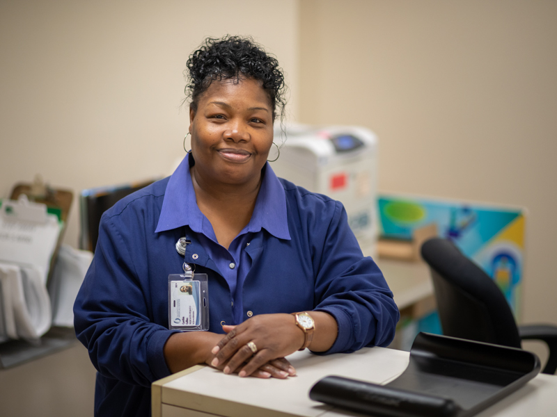 Cynthia Collins, a patient access specialist, greets all comers with a smile at Mammography Imaging.
