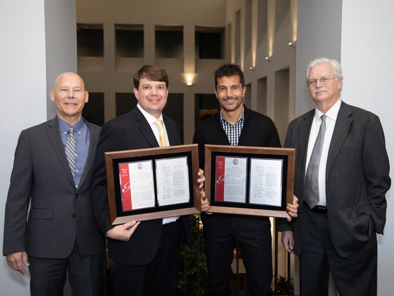 "Inventors Bidwell and Dr. Alejandro R. Chade with their patent, ""Kidney-Targeted Drug Delivery Systems"" with Patell and Summers."