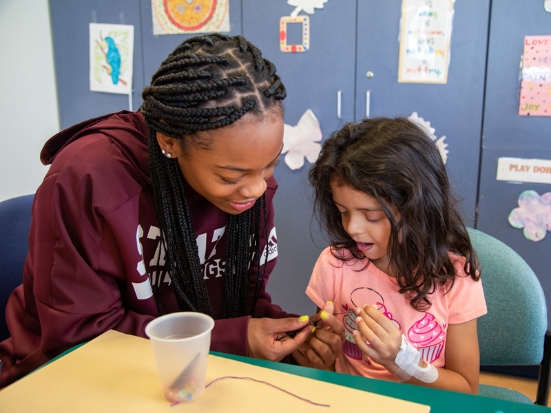 Women's Basketball Visits Score Wins With Children's