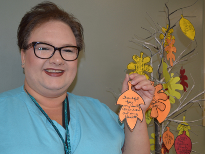 Shannon Strong, a pharmacy technician and patient advocate at the UMMC Cancer Center and Research Institute, created a small artificial tree at the center that bears leaves with gratitude messages from patients and employees.