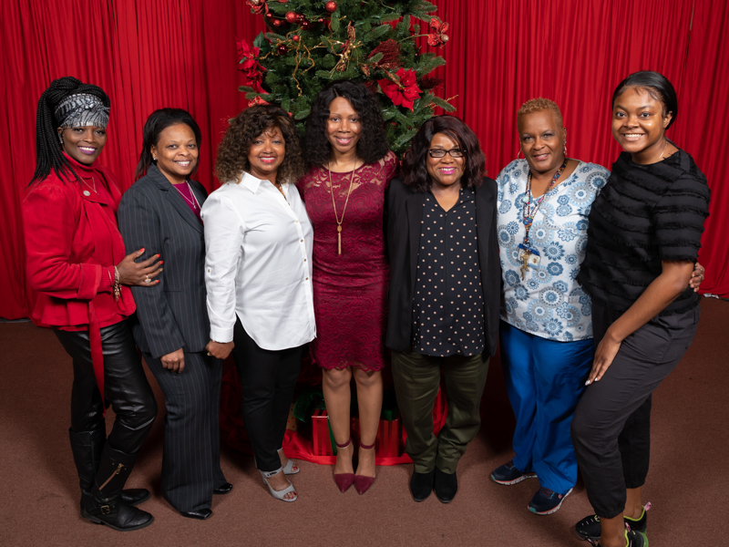 From left to right, make-up artist Shirley Lockett, Cassie King, Cynthia Lewis, Dwanda Moore, Audrey Smiley, Janice Johnson and Brie Kemp of Bonita Wig Boutique.
