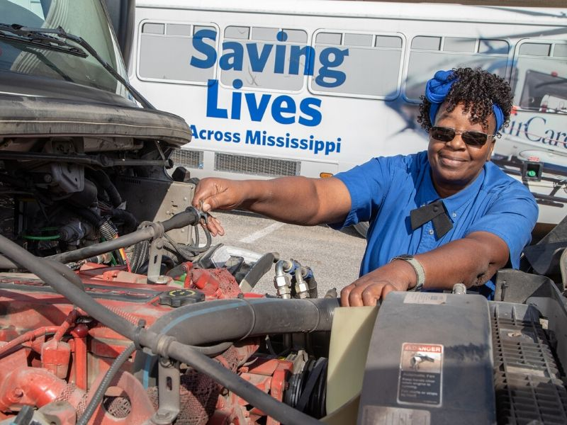 Jacqueline Williams checks oil and fluids of her bus, no. 962, before every shift.