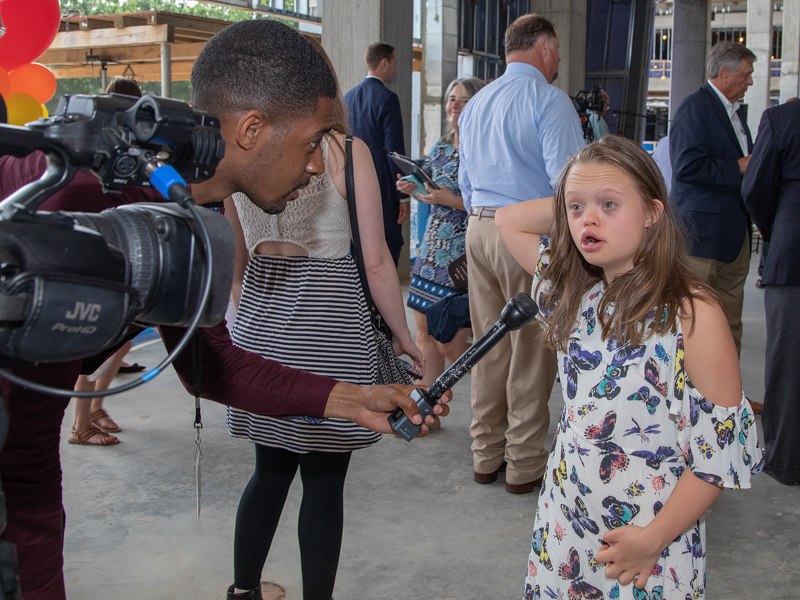 Marcus James of WJTV interviews Children's Miracle Network Hospitals Champion Aubrey Armstrong of Oxford before the start of the topping-out ceremony for Children's of Mississippi's expansion in June 2019.
