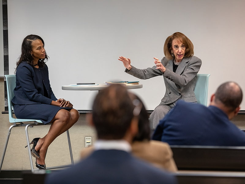Heidi Margulis, right, Humana advisor and John D. Bower School of Population Health executive in residence, speaks at a fireside chat facilitated by Dr. Michelle Owens, UMMC professor of obstetrics and gynecology.