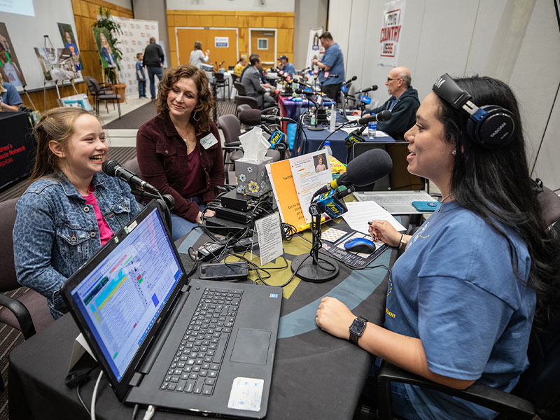 Children's of Mississippi patient Magnolia Jones of Bogue Chitto talks with Y101's Megan Macko as mom Emily Jones looks on.