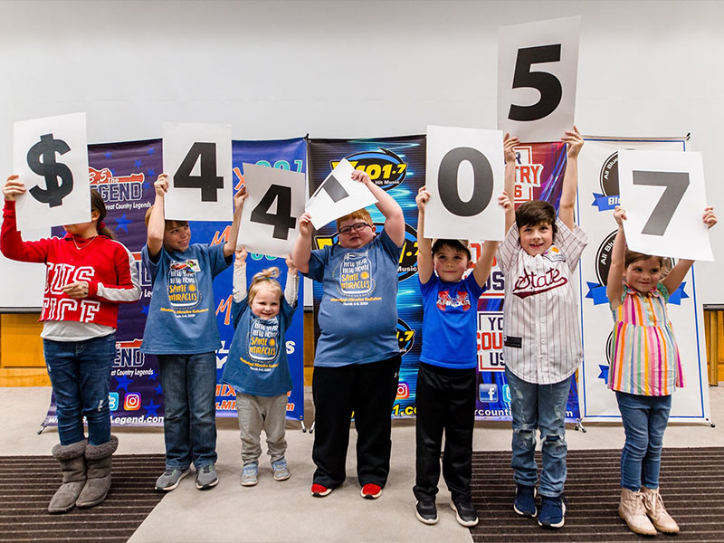 The total raised in the 19th annual Mississippi Miracles Radiothon is $441,057, and all of the funds will stay in Mississippi to benefit the state's only children's hospital. Revealing the sum are, from left, Savannah Grace Hendricks, Tucker Jones, Olivia Jones, Blake Stone, Jaxson Hemby, Brees Davis and Rorie Jane Davis.