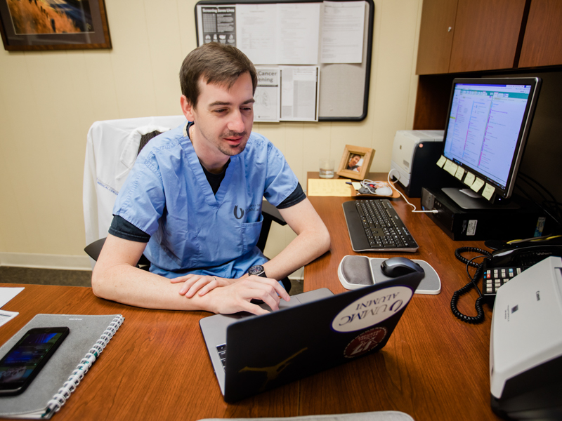 Normally, nurse practitioner and head of the Lung Cancer Early Detection Program Jonathan Hontzas spends his days seeing patients in clinic. He is now using his skills to screen individuals via telehealth who call in to the COVID-19 hotline.