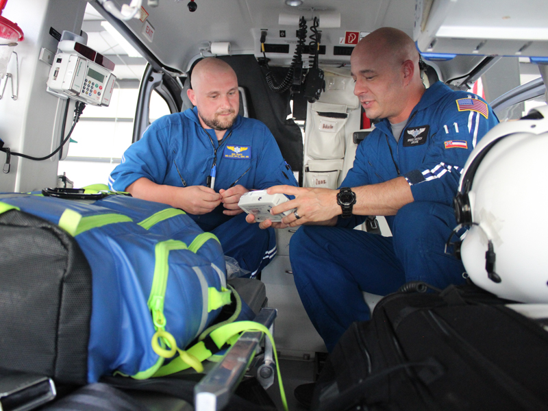 AirCare paramedic Ben White and registered nurse Brock Whitson check equipment prior to a flight. Photo courtesy of Bill Graham/The Meridian Star.