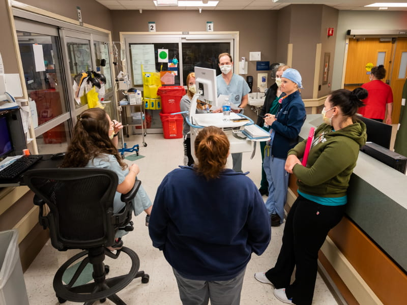 Teams comprised of attending physicians; residents and fellows; pharmacists; social workers; interns; and nurse practitioners make daily rounds in the medical ICU.