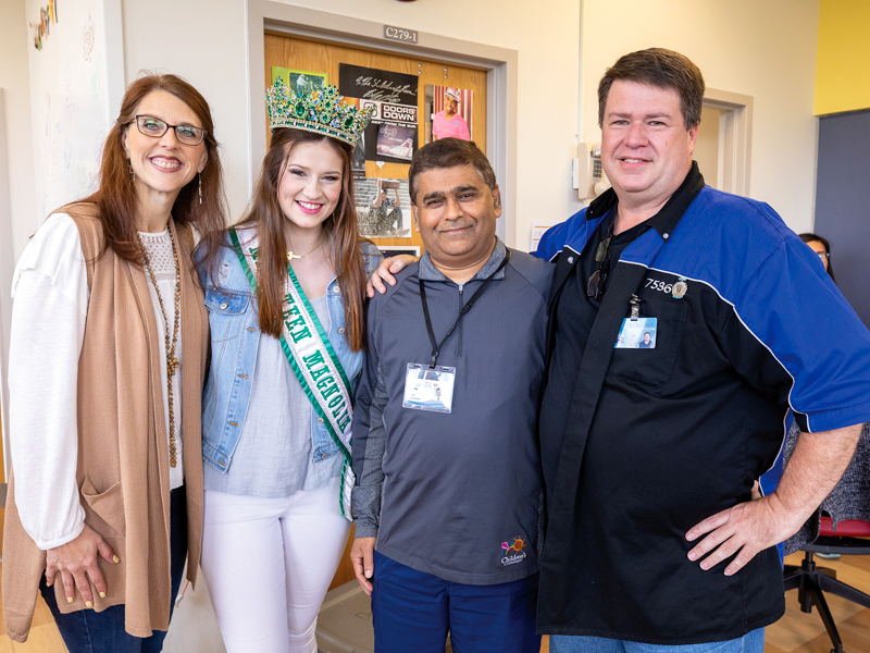 Dr. Abhay Bhatt, third from left, UMMC neonatologist, reunites with Savannah Richardson 18 years after the former patient left Batson Children's Hospital. With them are Richardson's parents, Jennifer and Bill.