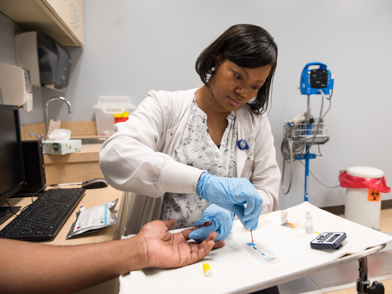 Clinical research nurse Jennifer Brumfield collects a blood sample for testing for HIV antibodies at UMMC's Express Personal Health clinic at the Jackson Medical Mall.