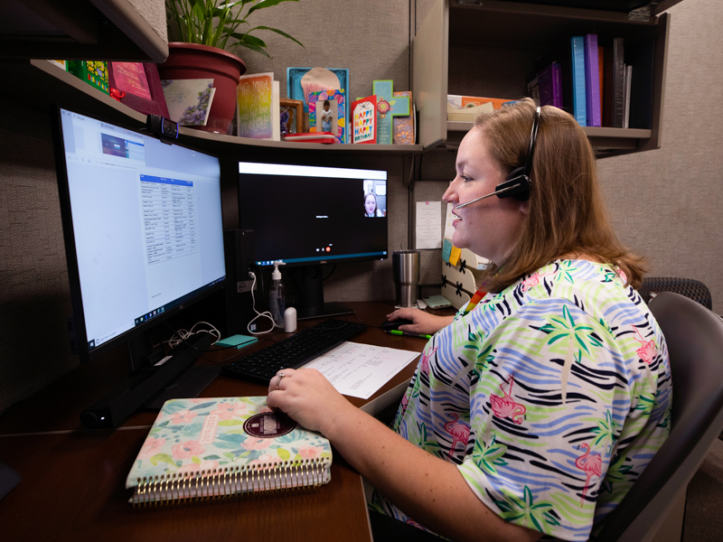 Courtney Sanders, nurse practitioner, visits via telehealth with a patient who lives with HIV.