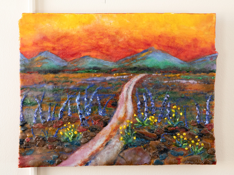 "Dr. Praise Matemavi's office wall is decorated with a painting she calls ""The Journey,"" a memento from her fellowship at the University of Nebraska Medical Center."