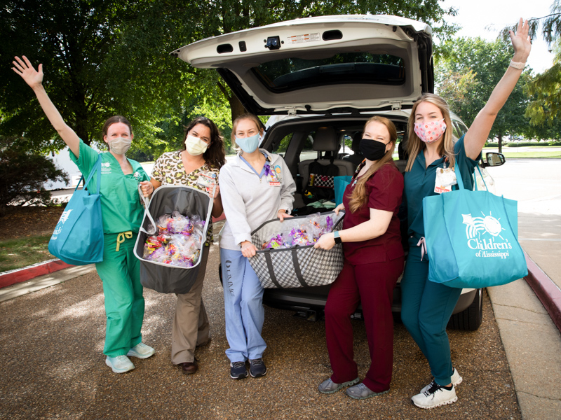 Nurses on 5C donated more than 300 goodie bags for Jackson Public Schools students and read stories to them as they picked up packets for distance learning. From left are Kayleigh Moore, Julia Joseph, Blake Fulton, Laura King and Kelley Wood.