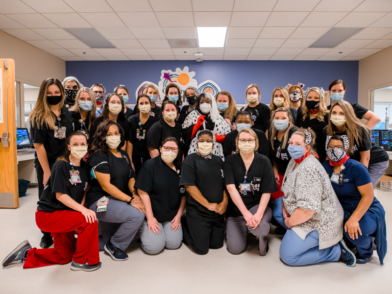 "The NICU medical team and Dr. Mobolaji Famuyide, center, celebrated Halloween on Friday by wearing costumes with the theme of ""101 Dalmatians."" Their patients wore Dalmatian-spotted onesies and caps."