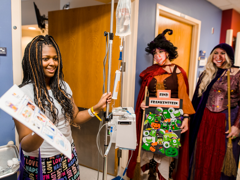 Children's of Mississippi patient Calvionne Fox of Hattiesburg plays a Halloween costume scavenger hunt game Friday with hospital staff including nurse practitioners Amy Lowery Carroll, center, and Amanda Hodges.