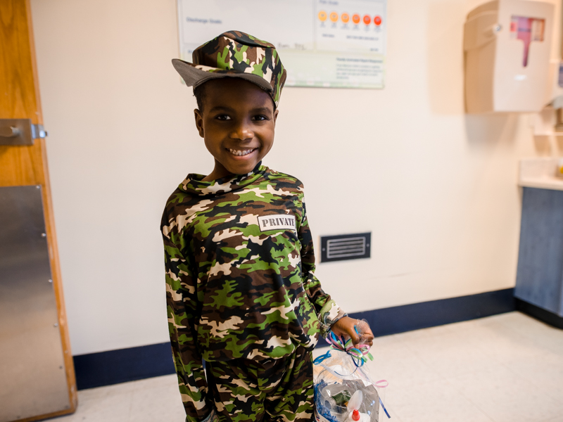 Children's of Mississippi patient Kaiyden Lynch of Jackson smiles in his Halloween costume Friday.