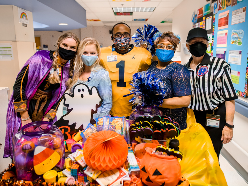 Bringing Halloween fun to Children's of Mississippi patients are, from left Avery Parman, Anna Peoples, hospital chaplain Mark Gilbert, Director of Pastoral Services Doris Whitaker and hospital chaplain Linda McComb.