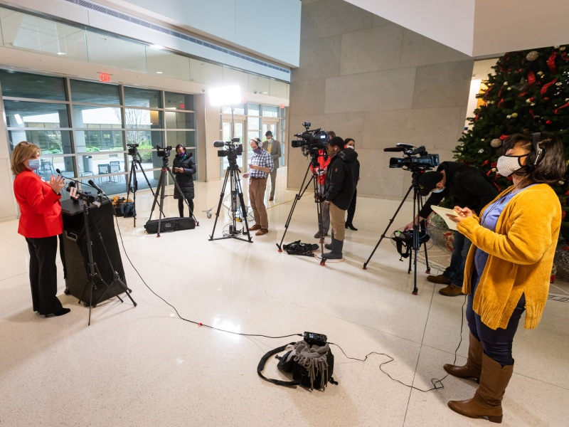Dr. LouAnn Woodward, vice chancellor for health affairs and dean of the School of Medicine, speaks to media Wednesday about the start of vaccinations for UMMC employees at highest risk.